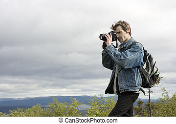 The image of the photographer against the nature