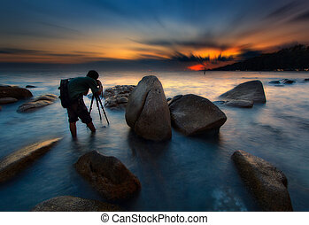 The photographer taking pictures of sunset at Khao Laem Ya,...