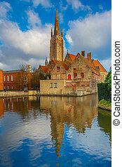 The picturesque city landscape in Bruges, Belgium - The...