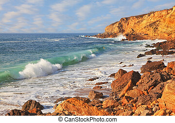 The picturesque coast of the Atlantic. The powerful ocean surf in Sintra, Portugal