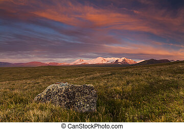 The picturesque mountain valley on the background of a beautiful sunset.