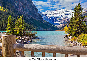 The picturesque promenade at Lake Louise. The lake is...
