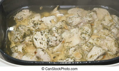 The pieces of chicken are cooked in a steamer