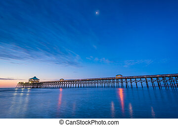 The pier at dawn, in Folly Beach, South Carolina.