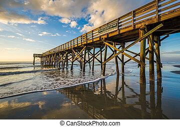 The pier at Isle of Palms at sunrise, near Charleston, South...