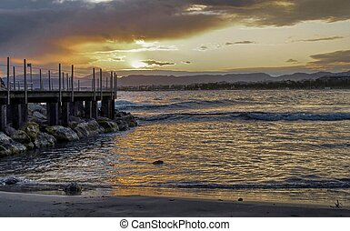 The pier at Salou beach, in Spain, during sunset