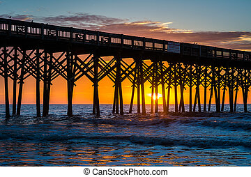 The pier at sunrise, in Folly Beach, South Carolina.
