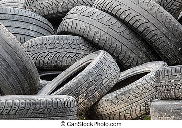 The pile of used automobile tires in the junkyard