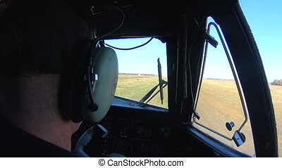 The pilot at the helm of the aircraft. View from the cockpit...