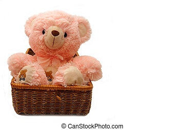 The pink bear sitting in a box