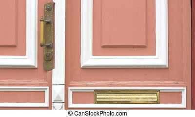 The pink door of an old town hall