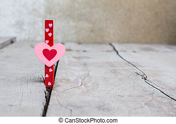 The pink heart on wooden