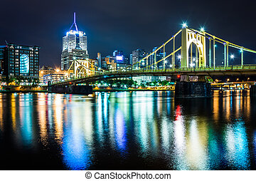 The Pittsburgh skyline and Roberto Clemente Bridge at night, seen from the North Shore in Pittsburgh, Pennsylvania.