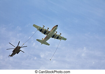 The plane and helicopter - Refuelling in air is made with...