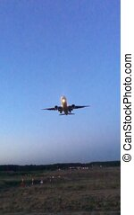 The plane approaches, flies overhead and comes in for a landing