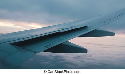 The plane drops over the sea and turns to the right, the view from the porthole on the wing of the aircraft