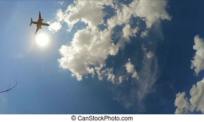 the plane flies in the cloudy sky. Slow motion. - the plane...