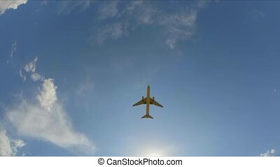 the plane flies through the cloudy sky. Slow motion. - the...