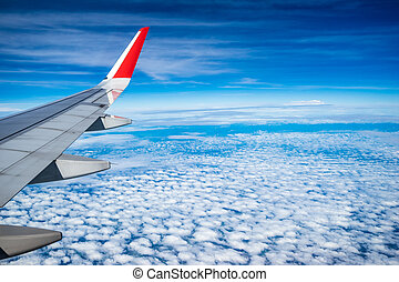 The plane on the clouds