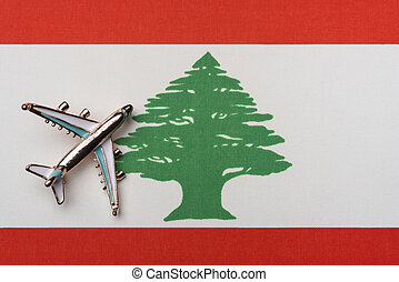 The plane over the flag of Lebanon, the concept of travel.