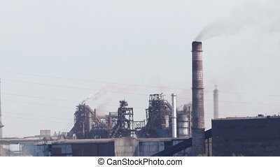 The plant at the river, heavy industry, the smoke from pipes...