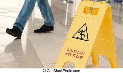 The plate is wet floor. People walk on the wet floor.