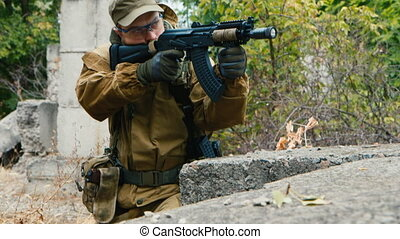 The player is sniping. Airsoft game