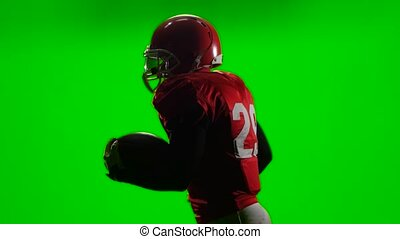 The player runs with the ball in his hand and throws it. Green screen