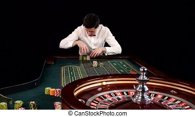 The player takes the won chips in casino. Back