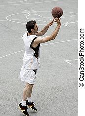 playing basketball player
