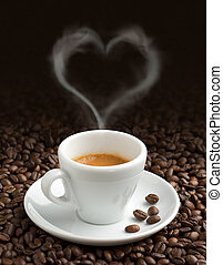the pleasure of coffee - coffee cup with heart-shaped steam ...