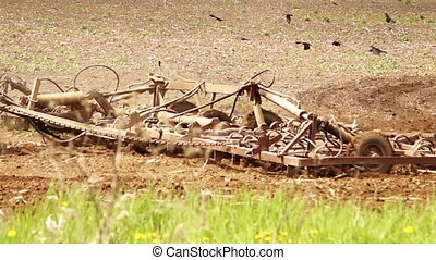 The plow cultivates the soil, close up, slow motion, full hd...
