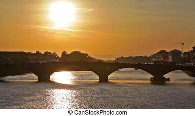 The Ponte alla Carraia across Arno river in sunset - Sunset...