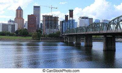 Portland, Oregon skyline and bridge over Willamette River -...