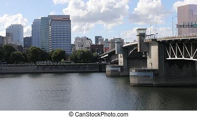 Portland, Oregon skyline by bridge over Willamette River -...