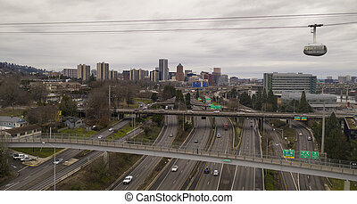 The Portland Tram Moves East over Interstate 5 Toward the Waterfront