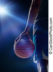 The portrait of a basketball player with ball - The portrait...