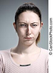 The portrait of a beautiful sad girl closeup