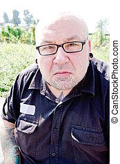 the portrait of a man wearing specs