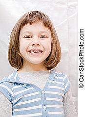 the portrait of little girl against white background
