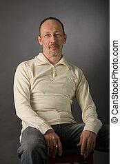 the portrait of senior man on grey background