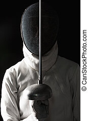 The portrait of woman wearing white fencing costume on black...