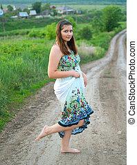 girl in light dress on the road