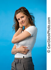 young woman - the portrait of young woman on blue background