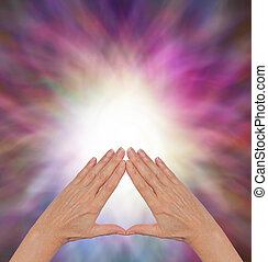 The Power of Pyramid Healing - Female hands making a...