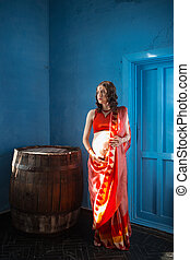 The pregnant woman with henna tattoo - Indian picture on...