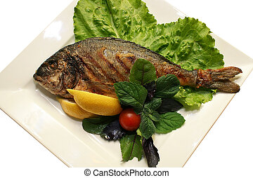 The prepared fish with vegetables on a plate