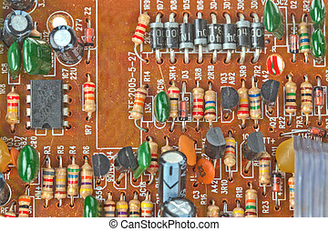 The printed-circuit board with electronic components macro background