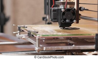 The printer prints the gear. A layer by layer appears on the...