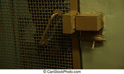 The prison door with a lock